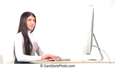 Businesswoman in office with desktop computer