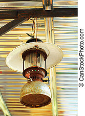 Rusty old kerosene lamp hanging
