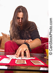 man with a deck of cards on the table in game