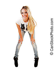 Girl bending down. - A slim young blond woman in jeans and...