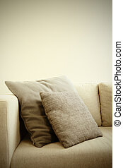 cushions - two cushions in sepia on a couch