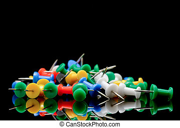 Push pins - Colorful push pins on black background