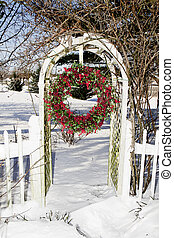 Cranberry Wreath Hanging in Trellis - Cranberry wreath...