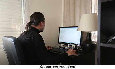 Home Office - brunette man typing computer at home office