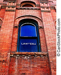Lawyer Sign on Window - Building and window with old worn...