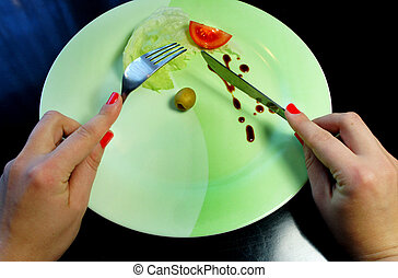 Big plate with a little piece of food and woman hands - Big...