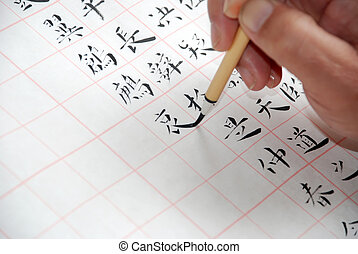 A man was writing Chinese calligraphy - One man was writing...