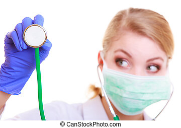 Doctor in mask with stethoscope