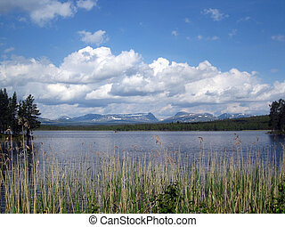 Scenic lake view with mountains