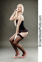 Sexy blonde wearing black lingerie and stockings