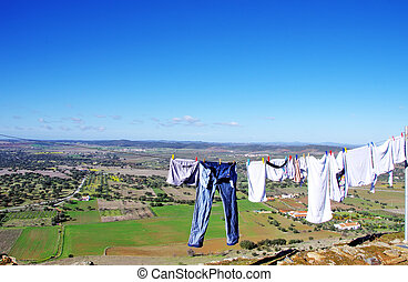 clothes line against a  landscape of Portugal