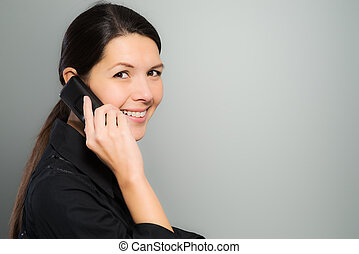 Attractive woman laughing on her mobile phone