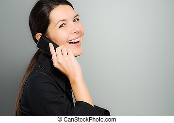 Attractive woman laughing on her mobile phone - Attractive...