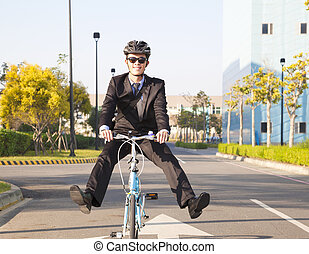 businessman riding bicycle to office for eco-friendly