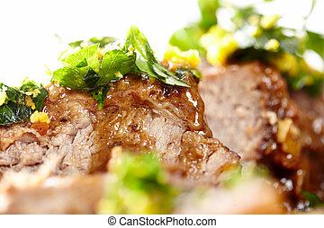 Slow cooked shin beef with orange gremolata - Closeup of...