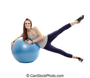 Athletic woman exercising with the ball
