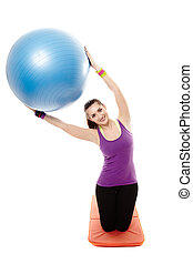 Athletic woman holding a ball and doing stretching