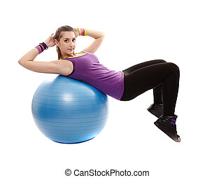 Athletic woman doing abs crunched on the ball