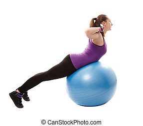 Athletic woman working her back muscles on the ball