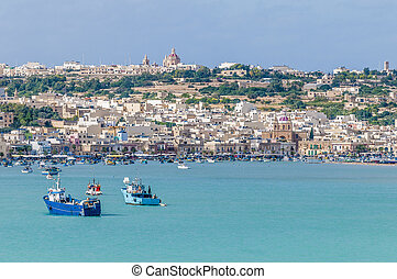 Harbor of Marsaxlokk, a fishing village in Malta. - Harbor...