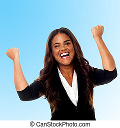 Excited businesswoman - Businesswoman clenching her fists in...