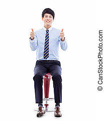 Young Asian business man sitting on the chair and showing...