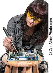 Woman soldering - Beautiful woman repair soldering a printed...