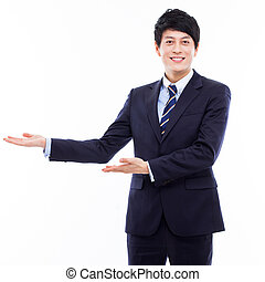 Young Asian business man showing something isolated on white...