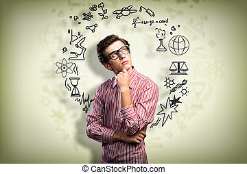 young man scientist with glasses thinking - young man...