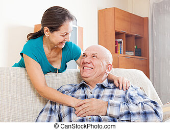 smiling senior man with happy wife