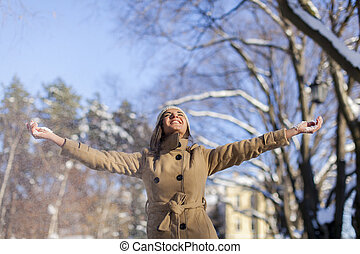 Happy young woman at winter