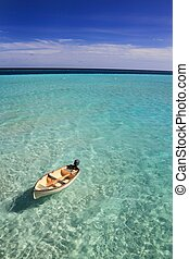 Boat drifting in the Maldives - A small rowing boat drifting...