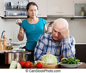 Family conflict Mature man and angry woman during quarrel -...