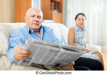 Happy couple of grandparents with newspaper - Smiling...