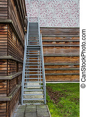 Steel stairs on a wooden building - Steel stairway on a...