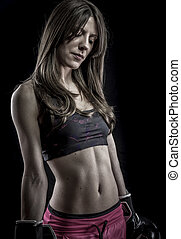 Body, strong woman athlete with boxing gloves