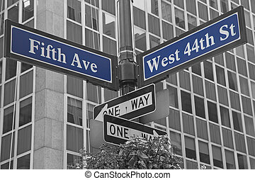 Street signs for Fifth Avenue and West 44nd street in...