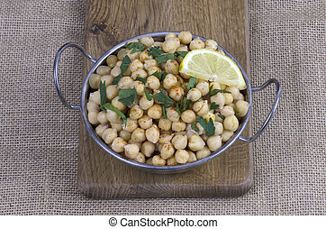 Cooked chickpeas - Bowl of cooked chickpeas with parsley and...