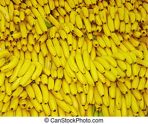 Banana - A very large pile of bright yellow Ripe bananas