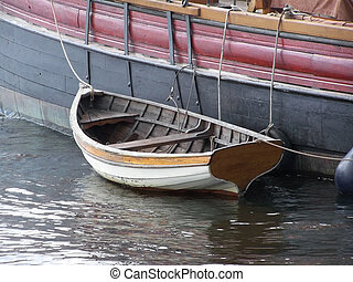 Dinghy to Tall Ship - Dinghy tied to A colorful tall ship in...