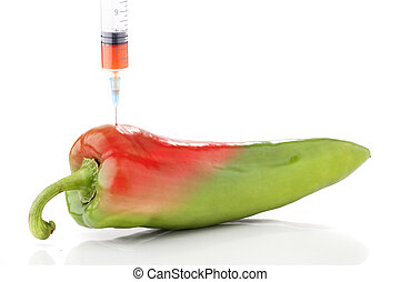 GMO - Paprika in two colors with a syringe. Concept for...