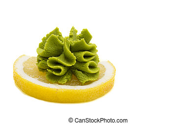 Wasabi on lemon isolated on white background