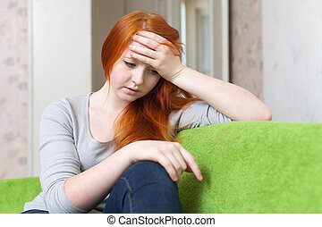 girl having disappointment in first love - Red-haired teen...