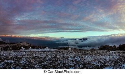 Fog descending the mountain slope. Timelaps