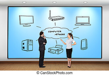 computer network - businesswoman and businessman looking at...