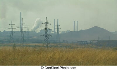 Industrial area. - System of high voltage lines against the...