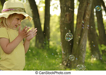 little girl with soap bubbles - a little girl with soap...