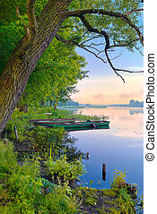 Morning over the river. - Two boats on The Narew river....