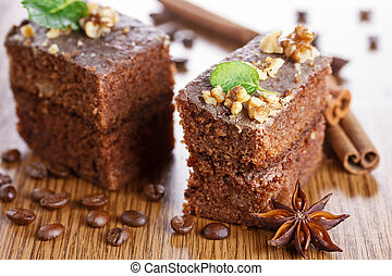 Slice of chocolate cake with nuts