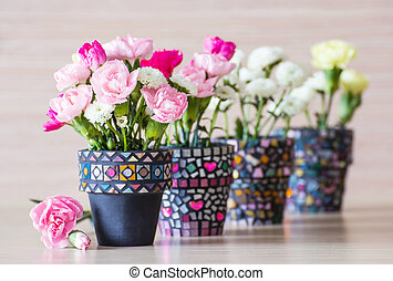 Carnation in mosaic flower pot